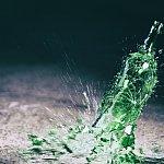 Green wine bottle hitting the floor and breaking