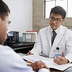 Doctor in consultation with male patient