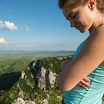 Woman with goosebumps overlooking a mountain range