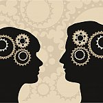 Silhouettes of a man and woman with gears in heads