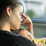 Stressed mom trying to nap with baby in car
