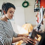 Young woman practicing piano at home